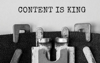 "The words ""content is king"" typed on a page"