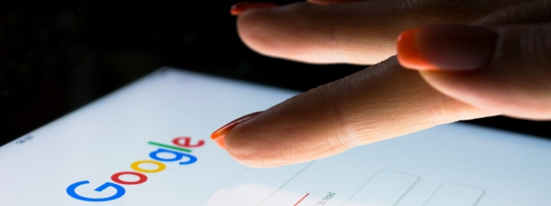 Woman's finger using Google on a smart phone