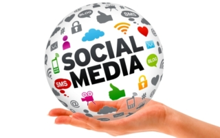 An upturned hand holding a globe that says social media, and contains social media icons